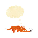Cartoon fox sniffing floor with thought bubble Royalty Free Stock Photos