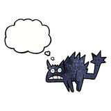 Cartoon frightened black cat with thought bubble Royalty Free Stock Images