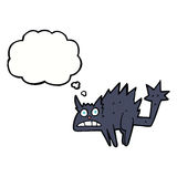 Cartoon frightened black cat with thought bubble Royalty Free Stock Image