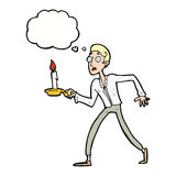 cartoon frightened man walking with candlestick with thought bub Stock Images