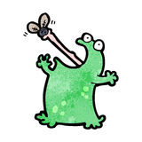 cartoon frog catching fly Stock Photography