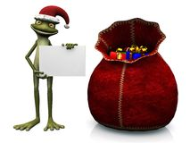 Cartoon frog wearing Santa hat, holding blank sign Royalty Free Stock Photo
