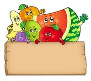 Cartoon fruits holding wooden table Stock Photography