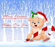 Cartoon funny baby bear holding Christmas candy with winter background. Illustration of Cartoon funny baby bear holding Christmas candy with winter background Royalty Free Stock Image