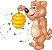 Cartoon funny bear holding Bee hive Royalty Free Stock Image