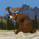 Cartoon funny bear runs with pants in hand Stock Photo