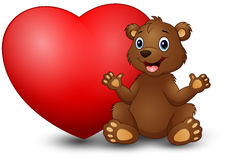 Cartoon funny bear sitting with a big heart Stock Image