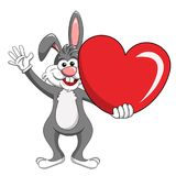 Cartoon funny character or mascot rabbit holding big heart isola. Ted on white Royalty Free Stock Image