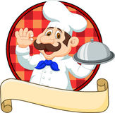 Cartoon funny Chef cartoon holding platter Stock Images