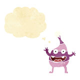 Cartoon funny creature with thought bubble Stock Photos