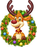 Cartoon funny deer holding Christmas Wreath with ribbons, balls and bow Stock Image