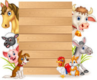 Cartoon funny farm animals with wooden sign Royalty Free Stock Image