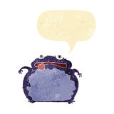 Cartoon funny frog with speech bubble Stock Images