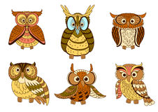 Cartoon funny owlets and eagle owl birds Stock Photography