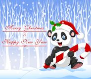Cartoon funny panda bear holding Christmas candy with winter background Stock Photo