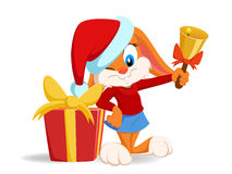 Cartoon funny rabbit with christmas hat and gift b Stock Photography