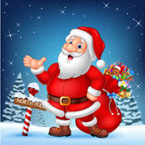 Cartoon funny Santa presenting with a north pole wooden sign Royalty Free Stock Photography