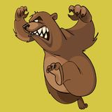 Cartoon furious brown bear runs on hind legs. On a yellow background Royalty Free Stock Photography