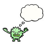Cartoon furry green monster Stock Image