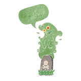 Cartoon ghost rising from grave with speech bubble Royalty Free Stock Images