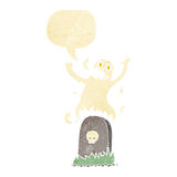 Cartoon ghost rising from grave with speech bubble Stock Image