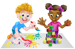 Cartoon Girl and Boy Playing With Blocks and Painting Royalty Free Stock Image