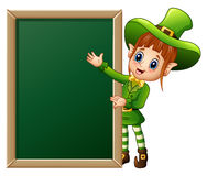 Cartoon girl leprechaun presenting with chalkboard sign Royalty Free Stock Photography