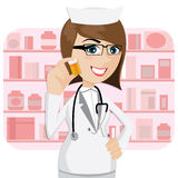 Cartoon girl pharmacist showing medicine bottle Stock Images