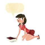 Cartoon girl picking up book with speech bubble Royalty Free Stock Image