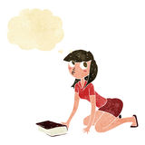 Cartoon girl picking up book with thought bubble Stock Images