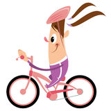 Cartoon girl with ponytail and helmet riding pink bike smiling. Funny cartoon happy girl with big smile and hat having a ride with her pink bicycle Stock Photo