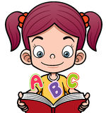 Cartoon girl reading a book Stock Images
