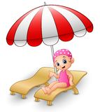 Cartoon girl relaxing on beach chair Royalty Free Stock Images
