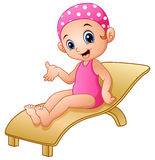 Cartoon girl sitting on beach chair Royalty Free Stock Photo