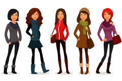 Cartoon girls in colorful autumn clothes Royalty Free Stock Photo