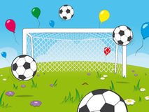 Cartoon goalposts with balloons and soccer balls. White cartoon goalposts standing in a meadow with colourful floating party balloons and soccer balls in a Royalty Free Stock Images