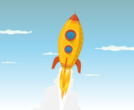 Cartoon Gold Space ship. Illustration of a cartoon rocket ship or UFO flying in the sky and going outer-space Royalty Free Stock Image