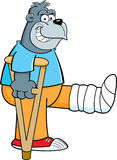 Cartoon gorilla on crutches Royalty Free Stock Photos