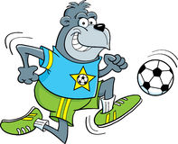 Cartoon gorilla playing soccer Royalty Free Stock Image