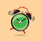 Cartoon green alarm clock with football Stock Image