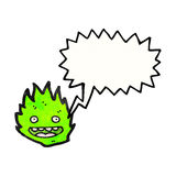 cartoon green fire creature with speech bubble Stock Image