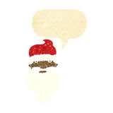 Cartoon grim santa face with speech bubble Royalty Free Stock Image