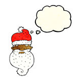 Cartoon grim santa face with thought bubble Stock Image
