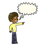 Cartoon grinning boy pointing with speech bubble Royalty Free Stock Images
