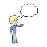 Cartoon grinning boy pointing with thought bubble Royalty Free Stock Images