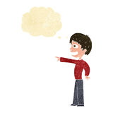 Cartoon grinning boy pointing with thought bubble Royalty Free Stock Photography