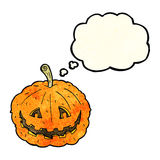 Cartoon grinning pumpkin with thought bubble Stock Photo