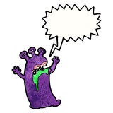 Cartoon gross alien with speech bubble Royalty Free Stock Images