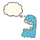 Cartoon gross ghost with thought bubble Stock Photo
