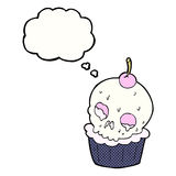 cartoon halloween cup cake with thought bubble Royalty Free Stock Photo